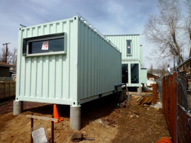 The very green six recycled shipping container home for Shipping container pier foundation